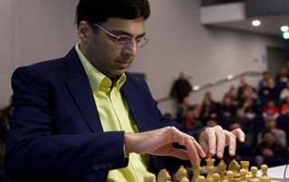 Anand draws with Caruana to stay in joint lead in Candidates