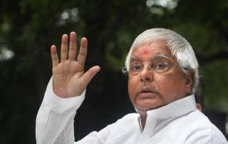 Lalu attacks RSS over dress change, says will 'bring them to half pants again'