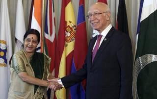 Swaraj, Aziz engage in 'social chitchat' at SAARC dinner