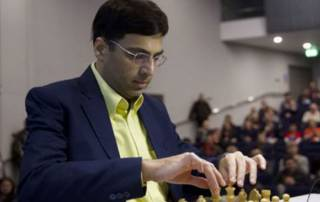 Anand beats Karjakin to come back in joint lead