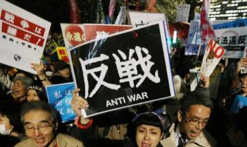 Japan defends new security laws as protesters denounce them