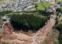 Rescuers race against landslides to reach Japan quake victims