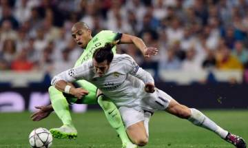 Real edge past City to set up all-Madrid final