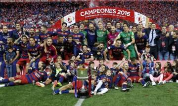 Copa del Rey: Barcelona edge out Sevilla in bad-tempered Cup