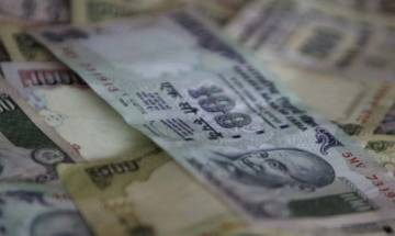 Rupee opens 3 paise higher against dollar at 66.74