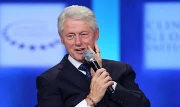 Bill Clinton in 'awe' of his wife, offers spirited endorsement