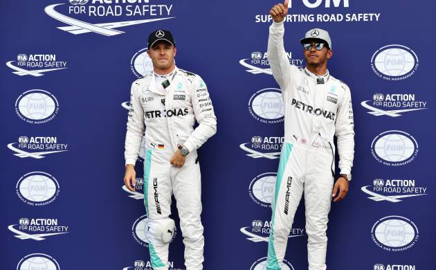 Nico Rosberg and Lewis Hamilton of Mercedes GP in parc ferme after qualifying for the Formula One Grand Prix of Germany at Hockenheimring on July 30, 2016 in Hockenheim, Germany.(Source: Getty Images)