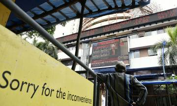 Sensex turns negative after 200-point rally