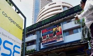 Sensex climbs back into green as RS clears GST Bill