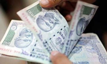 Rupee extends losses vs dollar, down 4 paise to end at 66.89