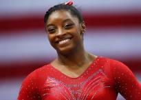 Biles's five gold bid ends as Wevers takes beam title