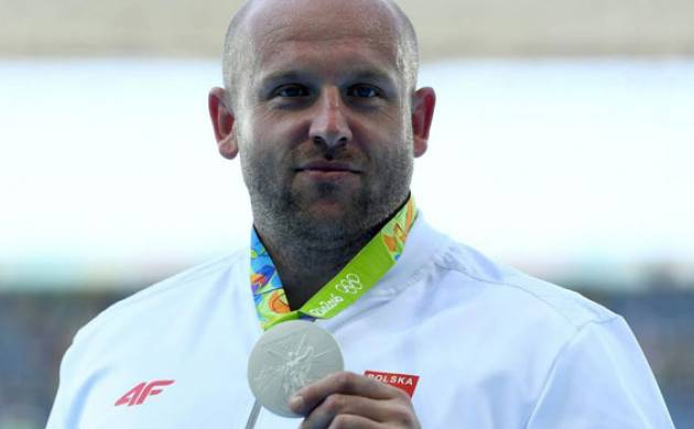Polish Olympian sells his medal to pay for a three-year-old battling camcer (Getty Images)