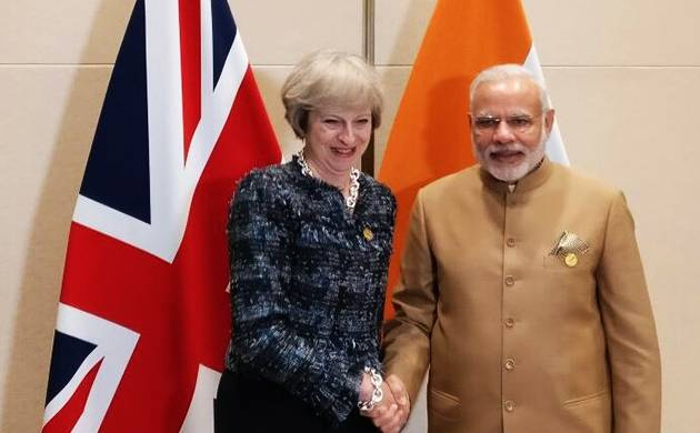 Prime Minister Narendra Modi meets Britain's Prime Minister Theresa May in Hangzhou, China (Image source: Twitter/MEA)