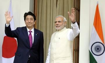 Prime Minister Narendra Modi meets Japanese PM Shinzo Abe in Laos ahead of ASEAN