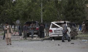 Suicide car bomber kills 14 including 10 Afghan police officers in Helmand city