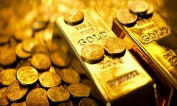 Gold prices fall by Rs 110 to Rs 30,590 at bullion market on Dhanteras