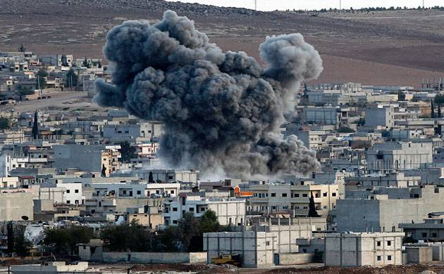 Smoke and dust rise over the Syrian town of Kobani after an airstrike. (Representational Photo: Getty Images)
