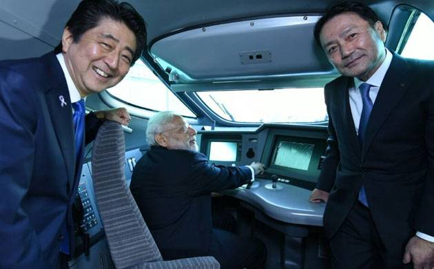 Prime Minister Narendra Modi inspects the console of a bullet train at the Kawasaki plant in Japan. (Twitter/MeA)