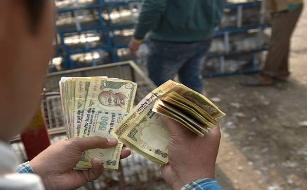 Cash worth Rs 4 crore seized from a Maharashtra-based trader in Burhanpur district in MP (Image: Getty)