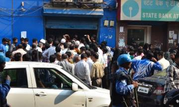 Currency Ban: ATMs remain cash strapped, customers line up in long queues