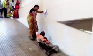 Watch video: Woman drags husband to first floor at Andhra hospital as hospital staff denies help