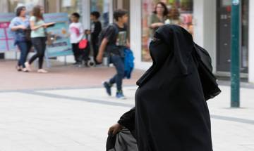 Hijab-clad US university student struck in face with glass bottle