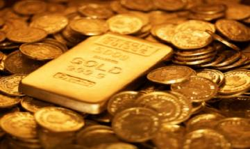Gold loses its shine by Rs100 on cash crunch and weak global cues