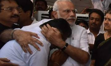 PM Narendra Modi hugs teary-eyed Panneerselvam after paying tributes to Jayalalithaa