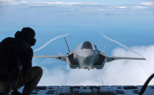 An F-35B aircraft approaches a KC-130J Super Hercules aircraft to re-fuel. (Getty Images)