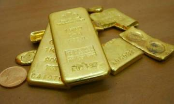 Gold loses sheen by Rs 100 on week domestic demand, Fed rate hike talk