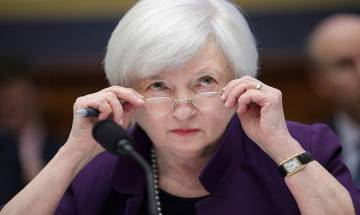 Fed hikes key rates by 25 bps, projects another three increase in 2017
