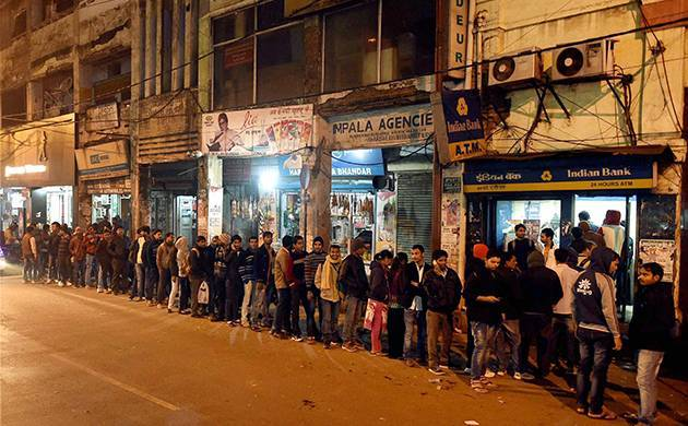 People stand in queue outside an ATM to withdraw cash. (PTI File Photo)