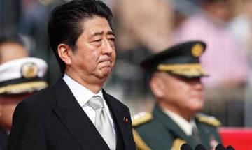 Japanese PM Shinzo Abe lays wreaths at memorials in Hawaii cemetries before historic Pearl Harbor visit