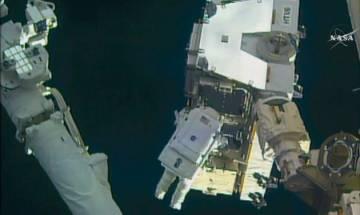 Spacewalking astronauts swap out batteries outside space station