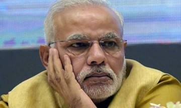 Unhappy PM  Narendra Modi leaves presentations made by secreatries midway