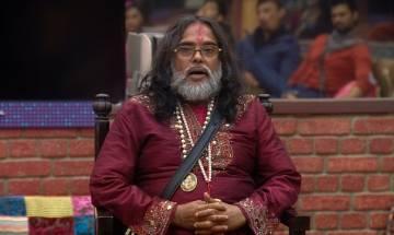 Watch   Om Swami caught changing clothes on Delhi railway station platform