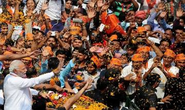 If not skull cap, Modi accepts shawl, flowers from Muslims during roadshow in Varanasi