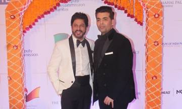 Shah Rukh Khan wishes 'happiness' to Karan Johar on becoming father, B-town pours in greetings