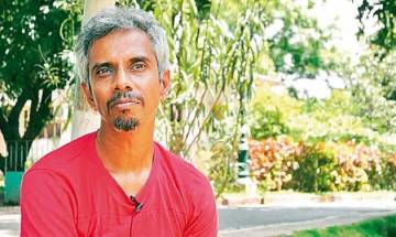 Face of Yogesh Master, author of controversial novel 'Dundhi,' smeared with black ink