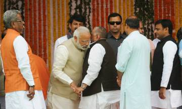 Yogi Adityanath's oath taking ceremony: Modi all ears to Mulayam, pats Akhilesh; Mayawati absent
