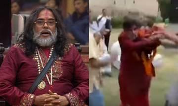 Watch video: Om Swami gets BEATEN publicly
