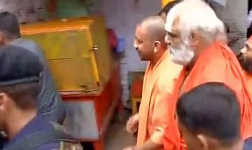 Uttar Pradesh CM Yogi Adityanath arrives in Ayodhya; visits Hanumangarhi Temple
