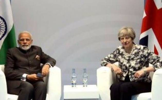 Modi meets May, discusses extradition of economic offenders