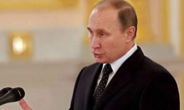 Donald Trump presses Vladimir Putin on allegations of Russian meddling in 2016 US election