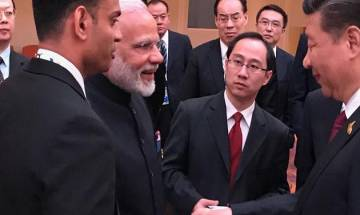 Picture speaks more than a thousand words, says MEA on Modi-Jinping Hamburg meet