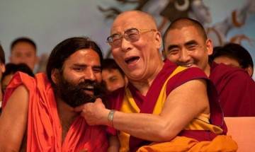 Dalai Lama tickles Ramdev on the stage of World Peace & Harmony Conclave, yoga guru touches monk's feet (watch video)