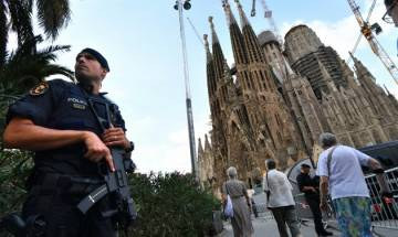 Police uncover arsenal of 120 gas canisters as Barcelona mourns