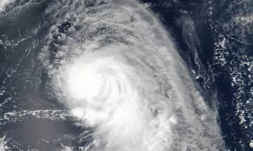 Typhoon Talim kills two as it rips through Japan