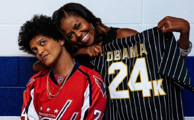 Bruno Mars gifts Michelle Obama personalised baseball jersey from his 24k Magic World Tour