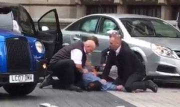 Car hits pedestrians near London's Natural History Museum